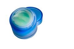 Kosmetische room in blauwe die kruik op witte achtergrond wordt geïsoleerd Royalty-vrije Stock Afbeelding