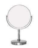 Kosmetisk spegel för skrivbords- smink som isoleras på vit Arkivfoto