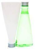 Kosmetiska flaskor (gräsplan och vit) Arkivfoto