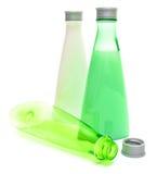 Kosmetiska flaskor på white Royaltyfria Foton