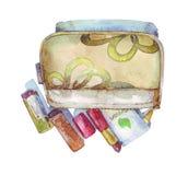 Kosmetyczna torba z pomadkami i śmietanką royalty ilustracja