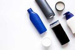 Kosmetyki dla mężczyzna w butelce na białego tła odgórnym widoku Zdjęcia Royalty Free