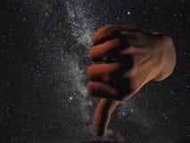 kosmiska ner tum Arkivbild