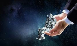 Kosmita w męskiej ręce Mieszani środki Obraz Royalty Free
