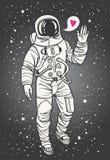 Kosmonaut mit der angehobenen Hand im Gruß und im Herzen Lizenzfreie Stockbilder