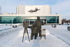 Kosmos theatre and Lumiere brothers sculpture in winter Royalty Free Stock Photos