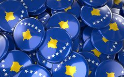 Kosovo Badges Background - Pile of Kosovan Flag Buttons. Royalty Free Stock Images