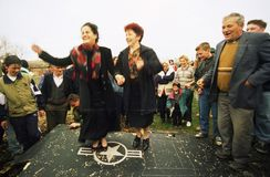 KOSOVO CRISIS. Serbian women dance atop the wing of an United States Air Force F-117A stealth fighter jet, which came down last night in Budjanovci, Serbia, on royalty free stock image