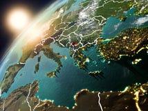 Kosovo op aarde in zonsondergang Stock Foto's