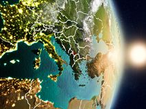 Kosovo during sunrise. Highlighted in red on planet Earth with visible country borders. 3D illustration. Elements of this image furnished by NASA Stock Images