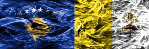 Kosovo vs Vatican city smoke flags placed side by side Stock Images