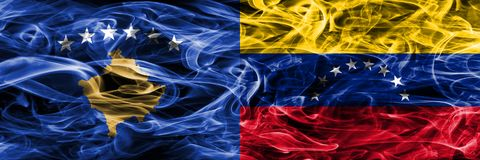 Kosovo vs Venezuela smoke flags placed side by side Stock Image