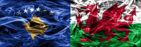 Kosovo vs Wales smoke flags placed side by side Royalty Free Stock Photos