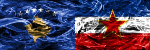 Kosovo vs Yugoslavia smoke flags placed side by side Royalty Free Stock Image