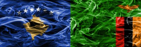 Kosovo vs Zambia smoke flags placed side by side Royalty Free Stock Photo