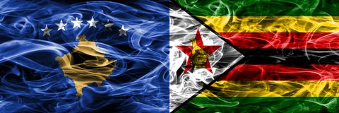 Kosovo vs Zimbabwe smoke flags placed side by side Royalty Free Stock Photos