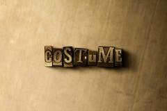KOSTÜM - Nahaufnahme des grungy Weinlese gesetzten Wortes auf Metallhintergrund Lizenzfreie Stockfotografie