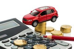 Kosten des Autos mit Taschenrechner Stockfotografie