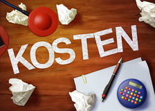 Kosten desktop memo calculator office think organize Stock Photos