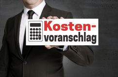 Kostenvoranschlag in german Cost estimate signboard is held by Royalty Free Stock Photography