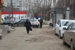 Moscow Oblast. Korolyov City. Kostino District. Dzerzhinskij street. Bad sidewalk. Kostino is the eastern part of the city center of Korolyov, Moscow Region stock photography