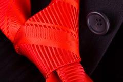 kostiumu czarny czerwony krawat Obraz Royalty Free