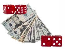 Kostka do gry i dolary Zdjęcia Stock