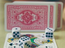 Kostka do gry, monety i karta do gry, Obraz Royalty Free