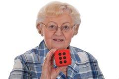 kostka do gry seniora kobieta Obrazy Stock