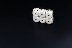 Kostka do gry sześć ones na czarnym tle Zdjęcie Royalty Free