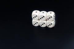 Kostka do gry sześć trójek na czarnym tle Zdjęcie Royalty Free