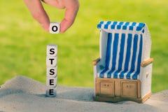 Kostki do gry tworzą Niemieckiego słowo «ostsee « obrazy stock