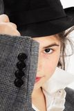 Kostuum, meisje en hoed Stock Afbeelding