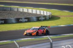 Kosuke Matsuura del GRUPPO di CORSA di AUTOBACS AGURI in GT500 Qualiflyi Fotografie Stock
