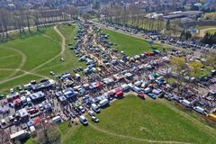 KOSZALIN, POLAND - 07 APRIL 2019 - Aerial view on Koszalin`s Gielda miscellaneous sunday market filled with crowds of buyers and. Seller`s makeshift stands stock image