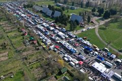 KOSZALIN, POLAND - 07 APRIL 2019 - Aerial view on Koszalin`s Gielda miscellaneous sunday market filled with crowds of buyers and. Seller`s makeshift stands royalty free stock photography