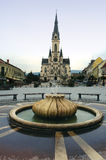 Koszeg town Hungary. Scenic view of church in downtown Koszeg with water fountain in foreground, Hungary stock photos