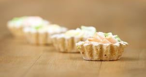 koszy kremowego deseru cztery cukierki Fotografia Royalty Free