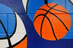 Koszykówek piłek farba na błękit ścianie Obrazy Royalty Free
