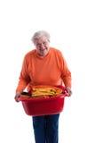 koszykowy mienia pralni senior Fotografia Royalty Free