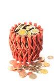 Koszykowy pełny monety odizolowywać na bielu Zdjęcia Stock