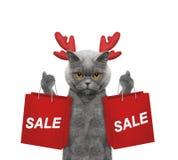 Kot z reniferowymi poroże podtrzymywał z torba na zakupy zdjęcia royalty free
