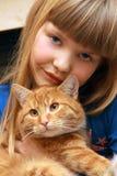 kota dziewczyny mienie Zdjęcia Stock