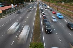 Road and vehicle moving back from work hours in kota kinabalu. royalty free stock photography
