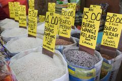 Various kinds of rice on basket for sale stock photo