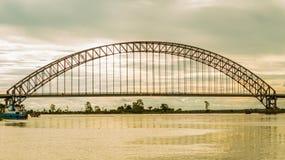 Arch bridge at dawn. Kotabangun arch bridge crossing Mahakam river at dawn, Borneo, Indonesia Stock Photography