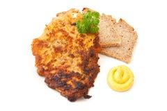 Kotelett mit Senf und Brot Stockfotos