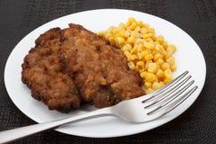 Koteletten met graan stock afbeelding