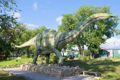 A sculpture of apatosaurus in the paleontologic park in the sunny day Stock Images