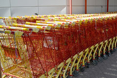 KOTKA, FINLAND. Empty trade carts stand near the building of shopping center Stock Photos